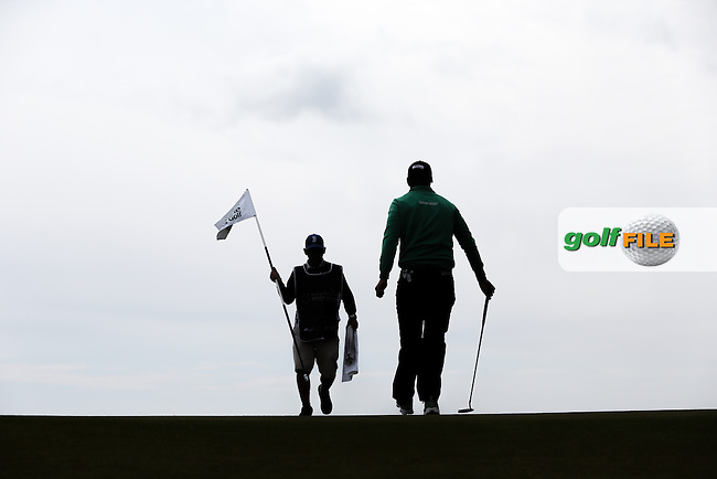 Silhouette of Lucas Bjerregaard (DEN) on the 8th during Round Three of the 2015 Dubai Duty Free Irish Open Hosted by The Rory Foundation at Royal County Down Golf Club, Newcastle County Down, Northern Ireland. 30/05/2015. Picture David Lloyd | www.golffile.ie
