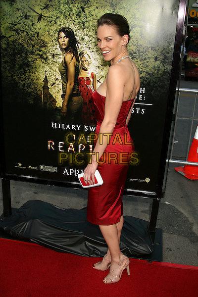 "HILARY SWANK.""The Reaping"" Los Angeles Premiere at Mann's Village Theatre, Hollywood, California, USA, 29 March 2007..full length red strapless dress.CAP/ADM/BP.©Byron Purvis/AdMedia/Capital Pictures."