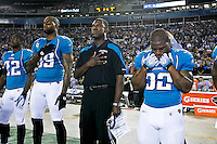 December 05, 2011:   Jacksonville Jaguars interim head coach Mel Tucker (c), stands for the National Anthem with Maurice Jones-Drew (32) and tight end Marcedes Lewis (89) prior to the start of action between the Jacksonville Jaguars and the San Diego Chargers played at EverBank Field in Jacksonville, Florida.  ........
