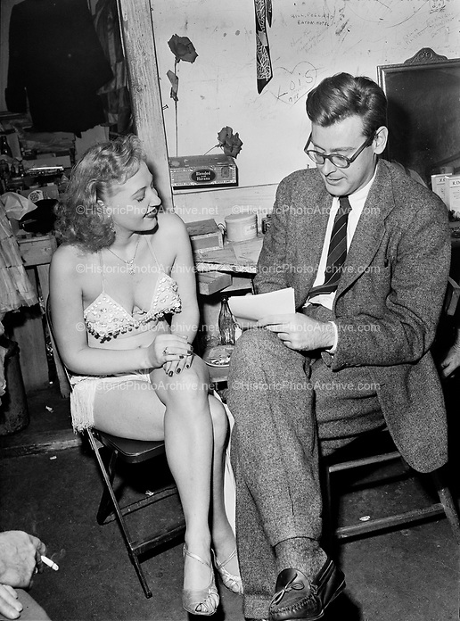 "9969-7491. Strip dancer in ""Pepper Box Revue"" being interviewed by Larry Howes of Oregon Journal. February 4, 1949."