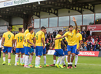 Goalscorer Lucas Paqueta (10) of Brazil celebrates at full time but appears to injury himself in the process during the International match between England U20 and Brazil U20 at the Aggborough Stadium, Kidderminster, England on 4 September 2016. Photo by Andy Rowland / PRiME Media Images.