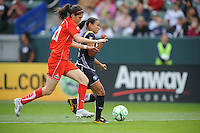 Los Angeles Sol (10) Marta and Washington's Alex Singer  battles for the ball during game against  the Washington Freedom  at the Home Depot Center in Carson, CA on Sunday, March 29, 2009..