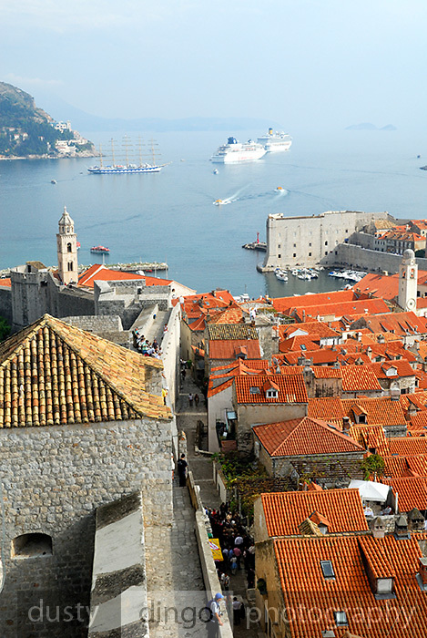 Elevated view of orange tiled roofs, narrow streets and harbour of Dubrovnik old town, Croatia