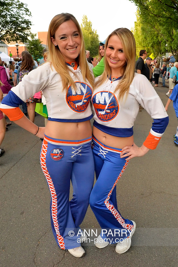 Garden City, New York, U.S. - June 6, 2014 -  L-R, ASHLEEN and JENNA, New York Islanders Ice Girls, are visiting the 17th Annual Garden City Belmont Stakes Festival, celebrating the 146th running of Belmont Stakes at nearby Elmont the next day. There was street festival family fun with live bands, food, pony rides and more, and a main sponsor of this Long Island night event was The New York Racing Association Inc.