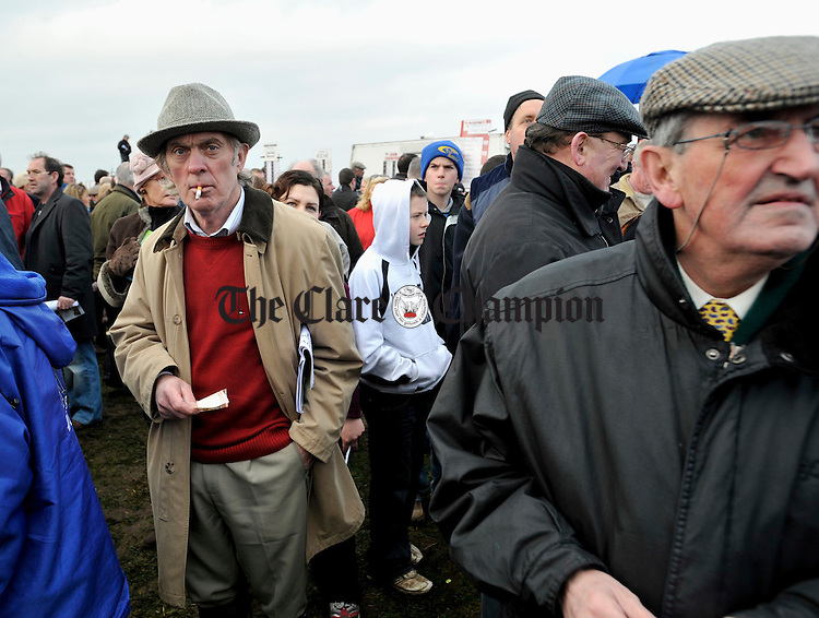 Tom Molloy of Moycullen, Galway, left, ponders his next move at the Point to Point in Bellharbour. Photograph by John Kelly.