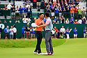 Rickie Fowler (USA) congratulates Rory McIlroy during the final round of the 143rd Open Championship played at Royal Liverpool Golf Club, Hoylake, Wirral, England. 17 - 20 July 2014 (Picture Credit / Phil Inglis)