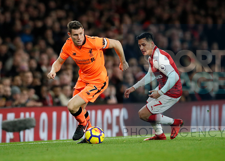 Arsenal's Alexis Sanchez tussles with Liverpool's James Milner during the premier league match at the Emirates Stadium, London. Picture date 22nd December 2017. Picture credit should read: David Klein/Sportimage