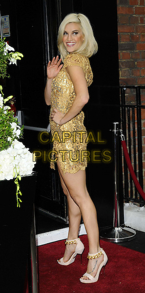 Ashley Roberts<br /> The KEY Fashion new online fashion boutique launch party, Vanilla, London, England.<br /> September 25th, 2013<br /> full length gold dress hand on hip side arm waving <br /> CAP/CAN<br /> &copy;Can Nguyen/Capital Pictures