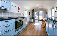 BNPS.co.uk (01202)558833<br /> Pic:    Savills/BNPS<br /> <br /> The kitchen area and living space inside one of the cabins.<br /> <br /> A country estate that has its own farm, tea rooms and glamping business in the heart of the Lake District has gone on market for those looking to escape the rat race.<br /> <br /> Backside Farm sits on the banks of Ullswater - the second largest lake in the Cumbrian National Park - and has one mile of water access as well as stunning views of the mountains. <br /> <br /> The outgoing owners have been on the 195 acre estate for over a decade and in that time they have renovated the large five bedroom farmhouse.<br /> <br /> They also set up the tea rooms and two holiday rental cabins and have established them as a business.