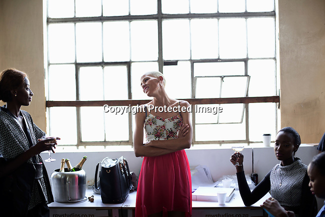 JOHANNESBURG, SOUTH AFRICA MARCH 23: Models drink champagne backstage after a fashion show at MOAD, Museum of African Design during Mercedes Benz Africa fashion autumn/ winter 2014 week on March 23, 2014 held in Maboneng District, Johannesburg, South Africa. Designers showed their best fall/winter collections. (Photo by: Per-Anders Pettersson)