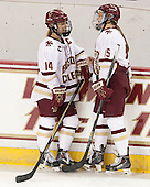 Emily Pfalzer (BC - 14), Emily Field (BC - 15) -  The Boston College Eagles defeated the visiting Boston University Terriers 5-0 on BC's senior night on Thursday, February 19, 2015, at Kelley Rink in Conte Forum in Chestnut Hill, Massachusetts.