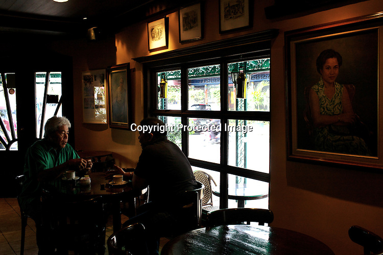 Customers sit together to have coffee at the Adriatico Cafe in Manila, Philippines. Photo: Sanjit Das