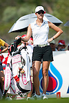 CHON BURI, THAILAND - FEBRUARY 19:  Michelle Wie of USA waits near her golf bag on at the 16th tee during day three of the LPGA Thailand at Siam Country Club on February 19, 2011 in Chon Buri, Thailand. Photo by Victor Fraile / The Power of Sport Images