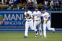 Yasiel Puig #66 of the Los Angeles Dodgers leads fellow outfielders Scott Van Slyke #33 and Andre Ethier #16 off the field after a game against the Atlanta Braves at Dodger Stadium on June 6, 2013 in Los Angeles, California. (Larry Goren/Four Seam Images)