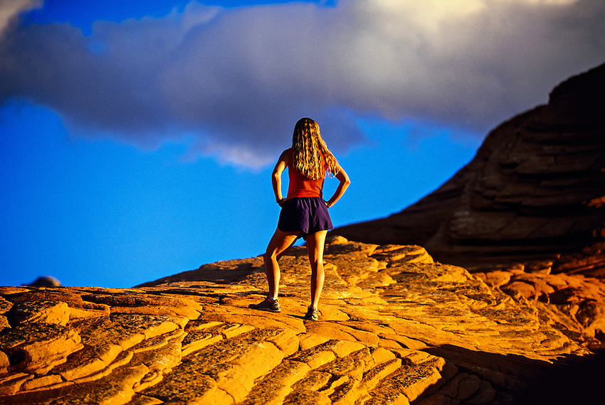 Woman runner, Snow Canyon State Park, near Ivins (near St. George), Utah USA