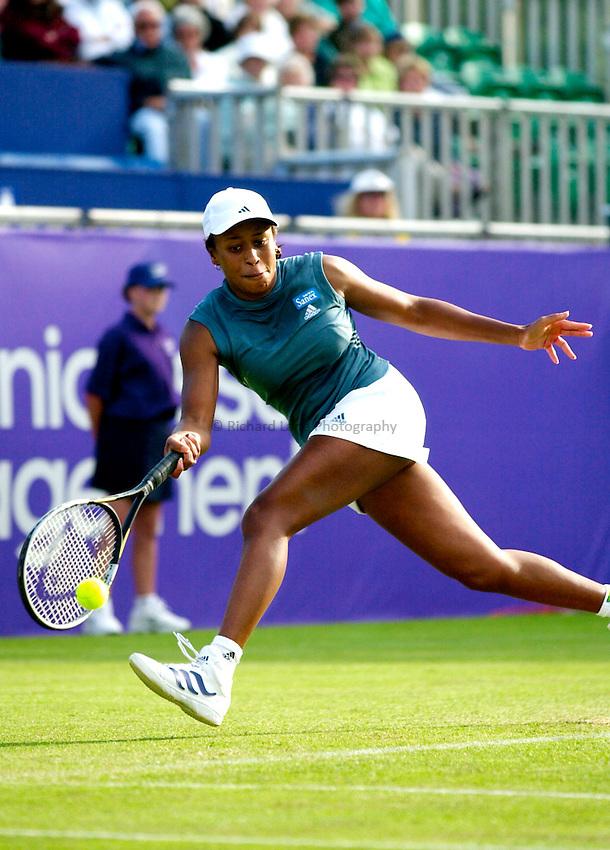 Photo. Rene Solari..20/6/01  .Eastbourne Tennis Day 3.  American Chanda Rubin puts her speed to work as she dashs across the court to return the ball to Spanish Conchita Martinez...