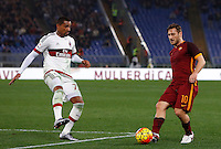Calcio, Serie A: Roma vs Milan. Roma, stadio Olimpico, 9 gennaio 2016.<br /> Roma's Francesco Totti, right, is challenged by AC Milan's Kevin-Prince Boateng during the Italian Serie A football match between Roma and Milan at Rome's Olympic stadium, 9 January 2016.<br /> UPDATE IMAGES PRESS/Riccardo De Luca