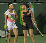 Martina Hingis (SUI) and Sania Mirza (IND) defeat Lara Arruabarrena (ESP) and Raluca Olura (ROU) 6-0