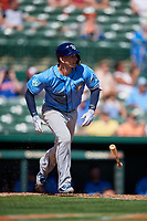 Tampa Bay Rays shortstop Daniel Robertson (28) runs to first base during a Grapefruit League Spring Training game against the Baltimore Orioles on March 1, 2019 at Ed Smith Stadium in Sarasota, Florida.  Rays defeated the Orioles 10-5.  (Mike Janes/Four Seam Images)