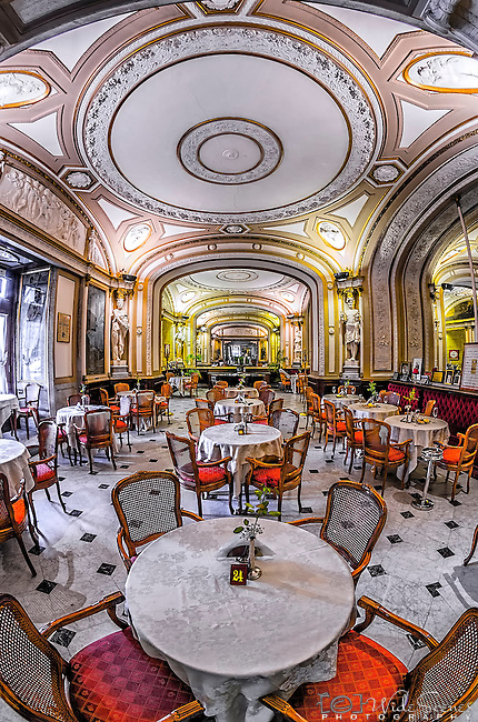A fisheye image of the interior of the Gambrinus Cafe in Naples, Italy. This famous cafe has been operating since 1860 and is conveniently located in the Centro Storico (Historical Centre) adjacent to Piazza Plebiscito and the Royal Palace.