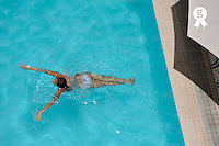 Teenager girl (15) swimming in pool (Licence this image exclusively with Getty: http://www.gettyimages.com/detail/83154229 )