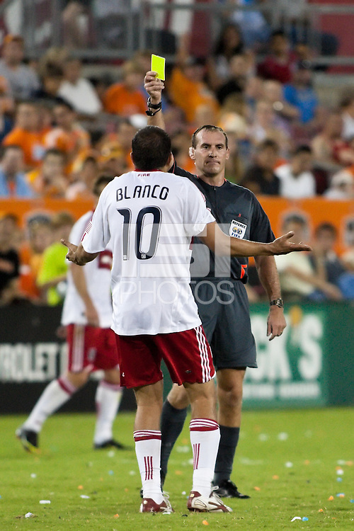 Chicago Fire midfielder Cuauhtemoc Blanco (10) receives a yellow card caution in the 73rd minute for a reckless foul from referee Terry Vaughn.  Houston Dynamo defeated Chicago Fire 3-2  at Robertson Stadium in Houston, TX on August 9, 2009.