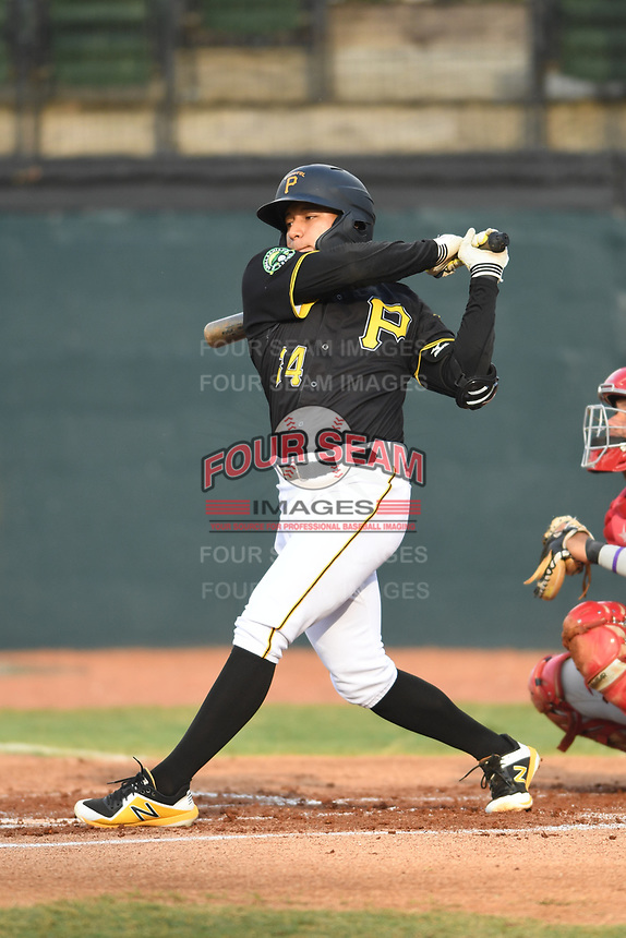 Fernando Villegas (34) of the Bristol Pirates follows through on his swing during a game against the Greeneville Reds at Boyce Cox Field on July 31, 2019 in Bristol, Virginia. The Pirates defeated the Reds 13-3. (Tracy Proffitt/Four Seam Images)