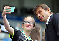 Manager of Chelsea, Antonio Conte has his picture taken by a young supporter as he arrives prior to the Premier League match between Swansea City and Chelsea at The Liberty Stadium on September 11, 2016 in Swansea, Wales.