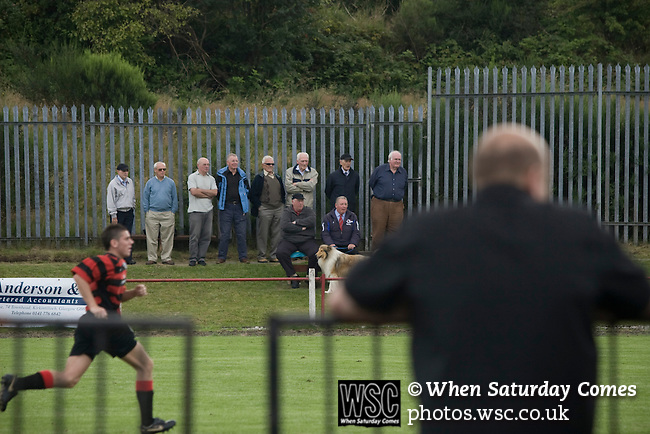 Kirkintilloch Rob Roy 1 Kilsyth Rangers 1, 16/08/2008. Adamslie Park, Sectional League Cup. Supporters watching Kirkintilloch Rob Roy (in red-and-black) taking on local rivals Kilsyth Rangers in a Sectional League Cup (Central) Section 8 tie at soon-to-be demolished Adamslie Park. The game ended in a 1-1 draw allowing Kilsyth to progress to the quarter-finals. Junior football was divided into East, West and North sections and played throughout Scotland. It had its own governing body, the SJFA and regional pyramid structure and national cup competition. Photo by Colin McPherson.