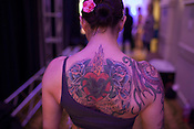 Detail of the tattoo on the back of Sarah Chenon, who performed at the 2014 Atlantic Pole Championships in Herndon, Va. on April 13, 2014. CREDIT: Lance Rosenfield/Prime for The Washington Post