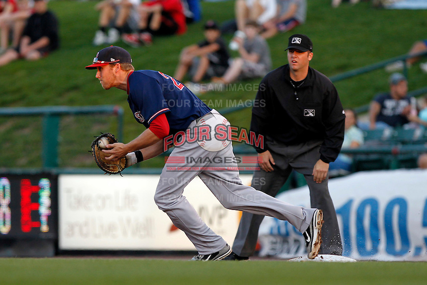 Pawtucket Red Sox first baseman Lars Anderson #26 chasing down a baserunner as umpire David Soucy looks on during a game against the Rochester Red Wings at Frontier Field on August 30, 2011 in Rochester, New York.  Rochester defeated Pawtucket 8-6.  (Mike Janes/Four Seam Images)