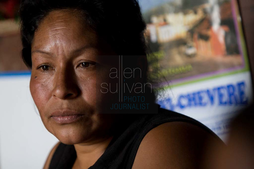 Miriam Violeta Montufa, mother of Alma de Los Angeles Sambrano  Montufa, 15, sits in their home in Chimaltenango, Guatemala on Thursday, March 8, 2007. Alma worked at Legumex, a vegetable and fruit company that exports to the United States, for a year and a half. Her mother also used to work at the plant, but can no longer work due to an illness. Both Alma and her mother say they know for certain that the plant hires underage workers for sometimes 14-hour shifts.