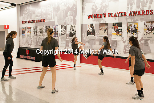 The Crimson warm up on the new concourse. - The Harvard University Crimson defeated the visiting Union College Dutchwomen 5-2 on Saturday, November 1, 2014, at the Bright-Landry Hockey Center in Cambridge, Massachusetts.
