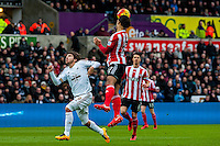 Virgil van Dijk of Southampton heads the ball in defence during the Barclays Premier League match between Swansea City and Southampton  played at the Liberty Stadium, Swansea  on February 13th 2016