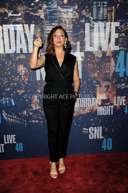 WWW.ACEPIXS.COM<br /> February 15, 2015 New York City<br /> <br /> Maya Rudolph walking the red carpet at the SNL 40th Anniversary Special at 30 Rockefeller Plaza on February 15, 2015 in New York City.<br /> <br /> Please byline: Kristin Callahan/AcePictures<br /> <br /> ACEPIXS.COM<br /> <br /> Tel: (646) 769 0430<br /> e-mail: info@acepixs.com<br /> web: http://www.acepixs.com