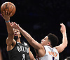 Spencer Dinwiddle #8 of the Brooklyn Nets, left, drives past Devin Booker #1 of the Phoenix Suns during an NBA game at the Barclays Center in Brooklyn, NY on Sunday, Dec. 23, 2018. Dinwiddle scored a team-high 24 points to lead the Nets to a 111-103 win.