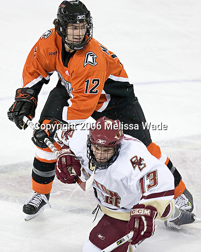 Tim Maxwell 12 of Bowling Green hooks while Pat Gannon 13 of Boston College holds. The Eagles of Boston College defeated the Falcons of Bowling Green State University 5-1 on Saturday, October 21, 2006, at Kelley Rink of Conte Forum in Chestnut Hill, Massachusetts.<br />