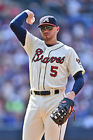 Atlanta Braves first baseman Freddie Freeman (5) throws the ball into the dugout during a game against the Chicago Cubs at Turner Field on June 11, 2016 in Atlanta, Georgia. The Cubs defeated the Braves 8-2. (Tony Farlow/Four Seam Images)