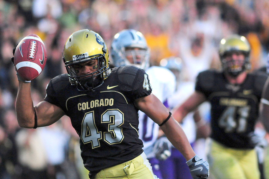 18 October 08: Colorado running back Rodney Stewart celebrates a rushing touchdown against Kansas State. The Colorado Buffaloes defeated the Kansas State Wildcats 14-13 at Folsom Field in Boulder, Colorado.