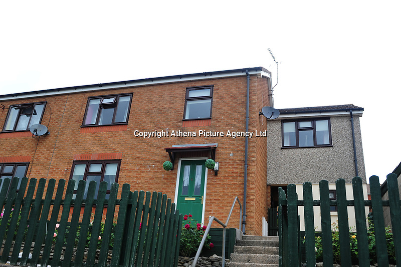 Pictured: A general view of the house where the Mother of David Gaut lives in Hengoed, Wales, UK. Wednesday 08 August 2018<br /> Re: Three men have been arrested after a man was found dead at a house in New Tredegar, Wales, UK.<br /> David Gaut, 54, was found in Long Row, in the Elliots Town area of New Tredegar, on Saturday, August 4.<br /> Two two-storey terraced homes, owned by Caerphilly council, have been cordoned off and police officers are patrolling the area. <br /> David Gaut was jailed for life in July 1985 when he was 21 years old, for the murder and torture of17-month old Chi Ming Shek