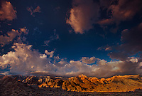 711700242 dawn light turns the eastern sierras below clearing storm clouds gold in the alabama hills blm lands in california