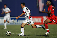 July 24, 2005: East Rutherford, NJ, USA: USMNT midfielder Landon Donovan (10) sprints past Panama's Alberto Blanco (8)  during the CONCACAF Gold Cup Finals at Giants Stadium.  The USMNT won 3-1 on penalty kicks.