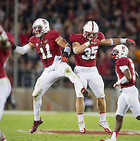 STANFORD, CA - November 7, 2013:  Stanford Cardinal linebacker Shayne Skov (11) and linebacker Jarek Lancaster (35) celebrate the fumble recovery during the Stanford Cardinal vs the Oregon Ducks at Stanford Stadium in Stanford, CA. Final score Stanford Cardinal 26, Oregon Ducks  20.