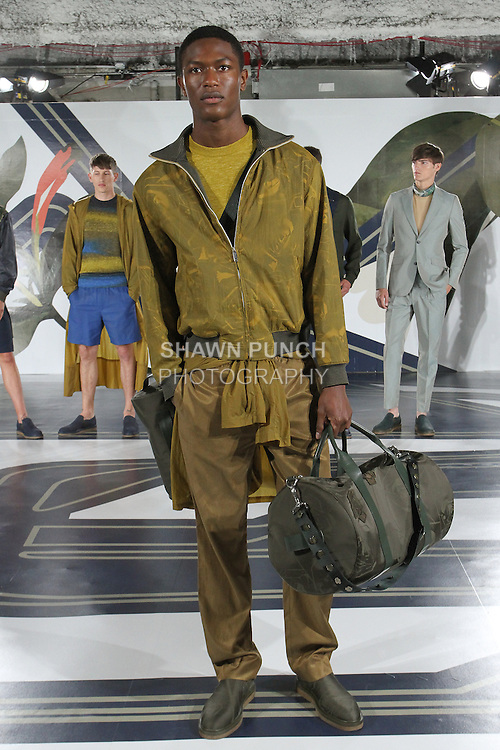 Model Hamid poses in a parachute nylon collage track jacket in Marigold, linen sweater T in yarrow, parachute nylon parka in Marigold, and cupro track pant in Marigold, from the Perry Ellis Spring 2017 collection by Michael Maccari, on July 11th 2017, during New York Fashion Week Men's Spring Summer 2017.