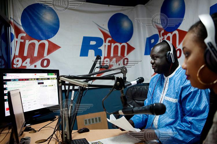 Radio presenter for the Wolof Journal, El Hadj Assan Gueye, during his show broadcast from the RFM (Radio Futurs Medias) studio.