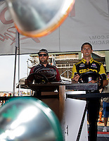 Jul. 26, 2013; Sonoma, CA, USA: NHRA top fuel dragster drivers Shawn Langdon (left) and Morgan Lucas play on the practice tree in the Toyota display during qualifying for the Sonoma Nationals at Sonoma Raceway. Mandatory Credit: Mark J. Rebilas-
