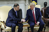 US President Donald J. Trump (R) shakes hands with Polish President Andrzej Duda (L)  during a meeting in the Oval Office of the White House in Washington, DC, USA, 12 June 2019. Later in the day President Trump and President Duda will participate in a signing ceremony to increase military to military cooperation including the purchase of F-35 fighter jets and an increased US troop presence in Poland. <br /> Credit: Shawn Thew / Pool via CNP