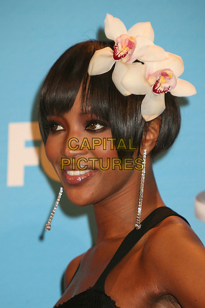 NAOMI CAMPBELL.38th Annual NAACP Image Awards at the Shrine Auditorium - Press Room, Los Angeles, California, USA, .2 March 2007..portrait headshot earrings black dress flower in hair clip accesory .CAP/ADM/BP.©Byron Purvis/AdMedia/Capital Pictures.