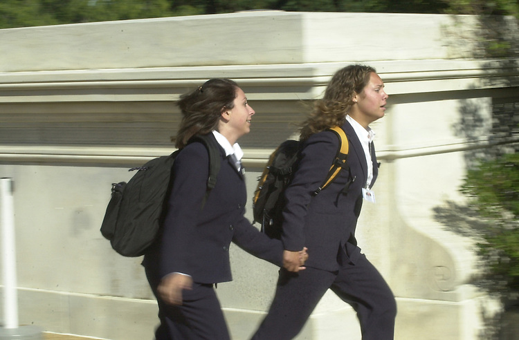 5bombscare091101 --  Students run from the U.S. Capitol after the announcement of evacuation.