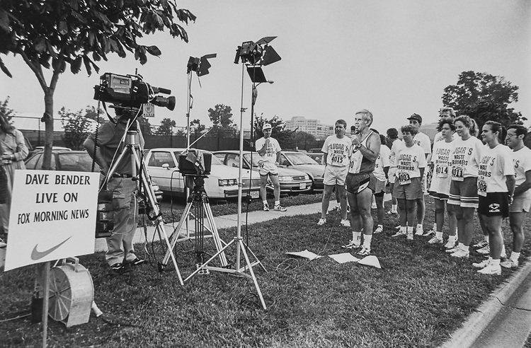 Sen. Richard Lugar, R-Ind., with (staff team in background) speaks to the press. 1991 (Photo by Kathleen Beall/CQ Roll Call via Getty Images)